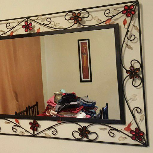 wrought black wrought iron mirror with decorative flowers