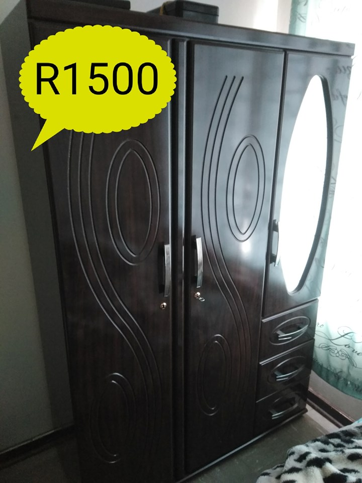 Dark wooden 3 door closet