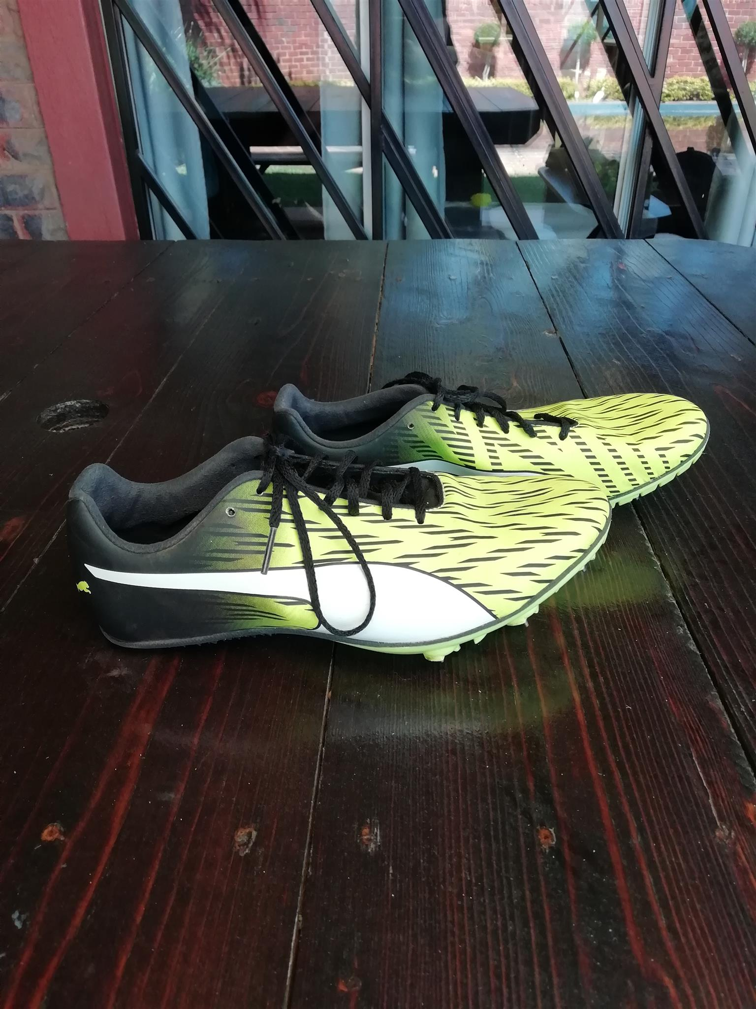 Black & yellow Puma sprinting spikes for sale