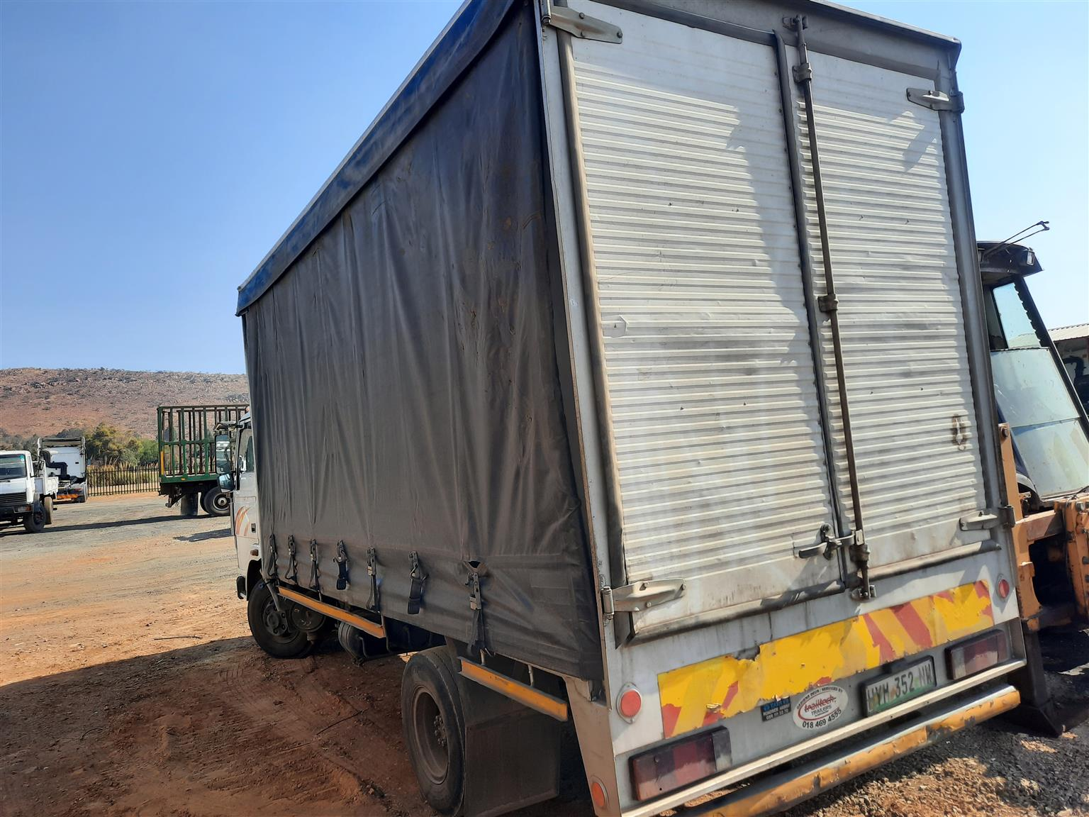 Tata 813 EX2 with curtain side body truck
