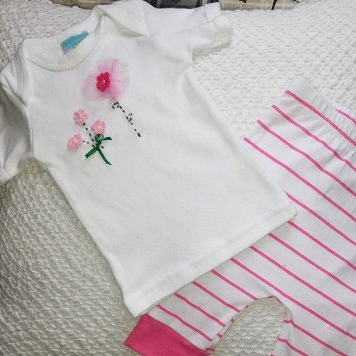 3 - 6 months Pink Baby shirt and white and pink stripes pants.