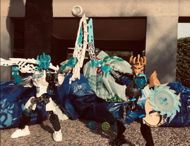Lego Bionicle pieces and 2 robots
