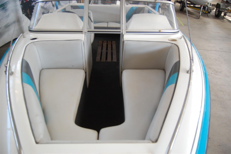 classic 210 on trailer 175 hp johnson v6
