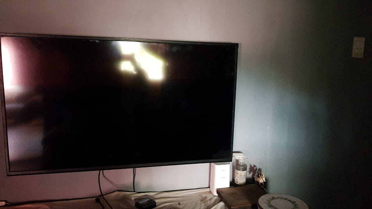 TV with remote and wall mount