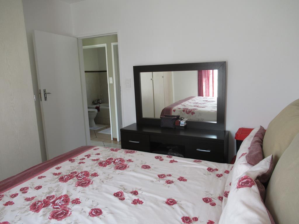 2 bedroom 1 bath ground floor unit  Equestria. Large corner garden