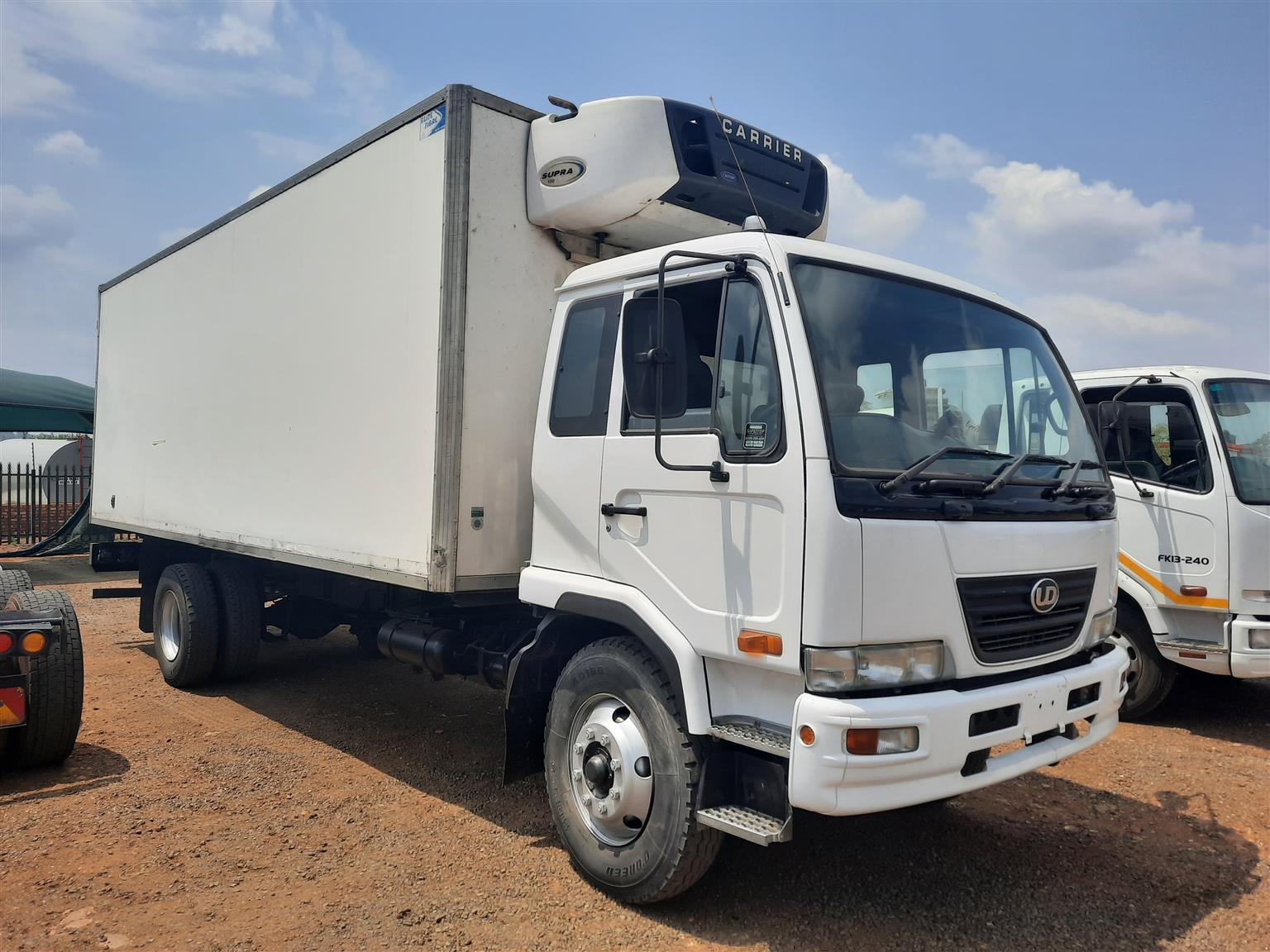Nissan UD 90 fitted with insulated body and fridge truck