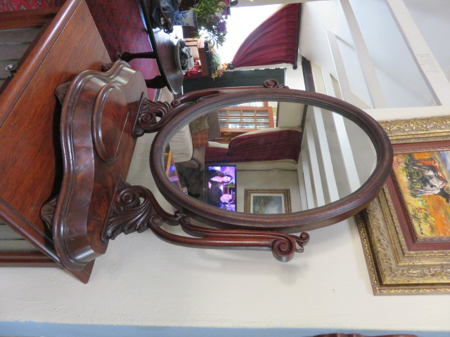 Circa 1830 mahogany dressing table mirror with hinged compartment.