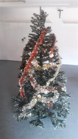 Very tall (2.2m) Christmas tree with decorations. Very good condition. Decorations separate photos.
