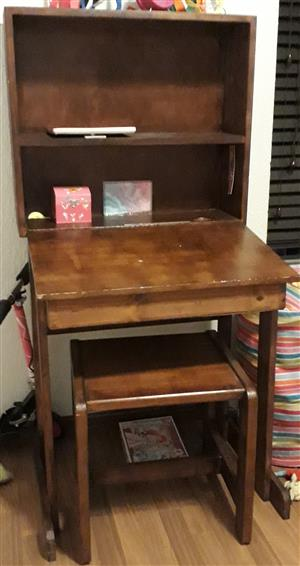 Old style school desk, built in book shelves and a stool.