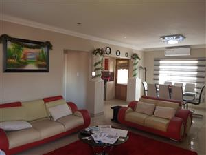 Upmarket 4 bedroom, 4 bathroom townhouse with double garage in Hazeldean, Pretoria.