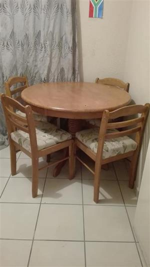 Wooden round table with 4 chairs