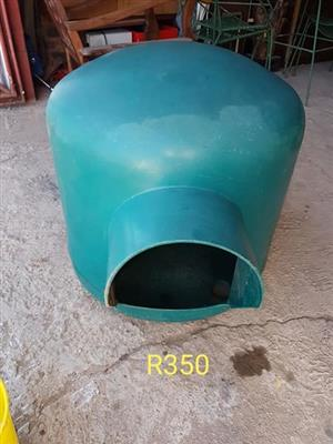 Large green dog kennel
