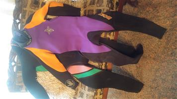 Two women's wetsuits for SALE - size small