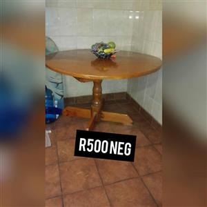 Round wooden kitchen table