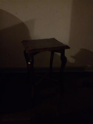 Dark wooden side table