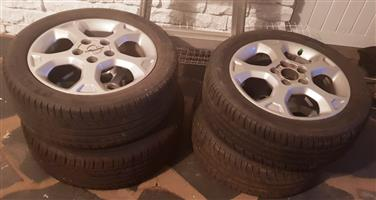 4 x OPEL 16 MAGS 5 Hole with 110PCD 205/50 R16