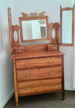 Yellow wood chest of drawers with mirror.