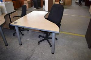 Light wooden cubicle desk with chair