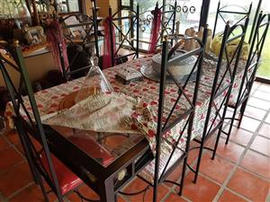 8 Seater Steel and Glass Top Dining Table for sale.