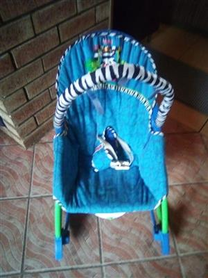 Blue baby rocking chair