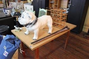 Wooden table, wine holder and bulldog
