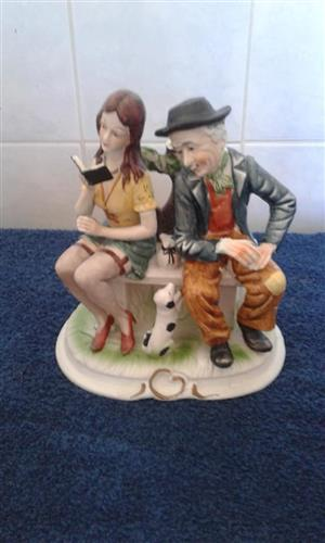 Old man and girl statue