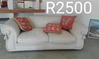 Beige 2 seater couch