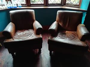 2x geniune leather wing back chairs.