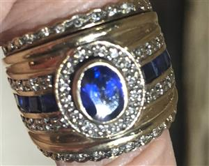 9 carat gold ring with diamonds and sapphires
