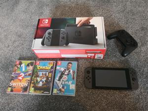 Nintendo Switch console with games & pro controller