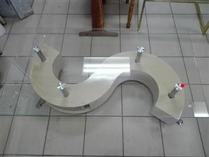 Glass top s shaped table