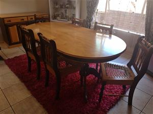 Embuia and yellow wood dining table with 6 chairs and cabinet