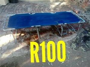 Blue camping stretcher Te koop