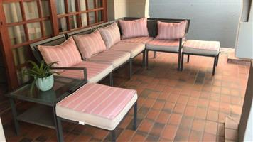 PATIO SET. 8 PIECE. Aluminium frame with artificial wicker seating. 5 x chairs 2 x ottomans & 1 x side (coffee) table