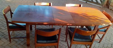 7 peace extendable solid Imbuia dining table.