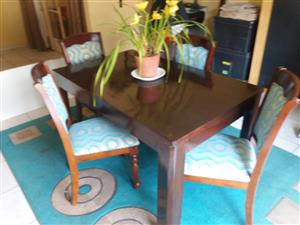 Solid wooden table and 4 high back chairs