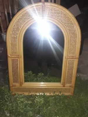 Cane arched framed mirror