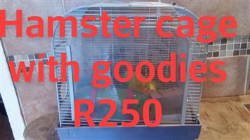 Hamster cage with goodies for sale