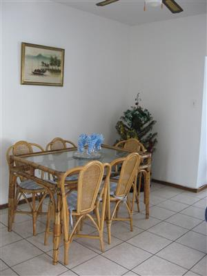 6 SEATER CANE GLASS TOP DINING ROOM TABLE AND 6 CHAIRS AND CUSHIONS R1500 LOTS OF OTHER ITEMS