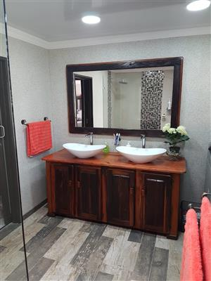 Bathroom cupboards and mirrors and other furniture