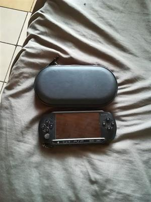 Psp + charger + pouch and 36 games