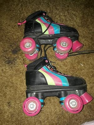 Black and pink roller blades for sale