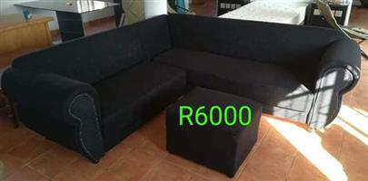 L Shaped black lounge suite