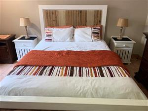 CORICRAFT MOKKA SLEIGH BED & PEDESTALS. BED BRAND NEW, NOT USED with 2 x White bedside tables.