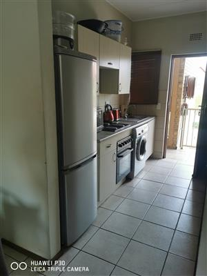 I am looking for tenant to share a 2 bedroom townhouse in samrand, SummerfieldsEstate