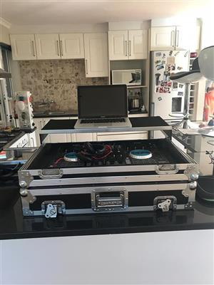 Dj controller with flight case for sale.