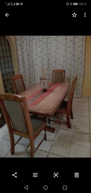 Wooden dining room suite with 6 chairs