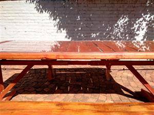 Wooden Table with glass surface and benches