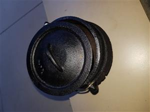 12 x 1/4 size cast iron potjies.  Only used once.