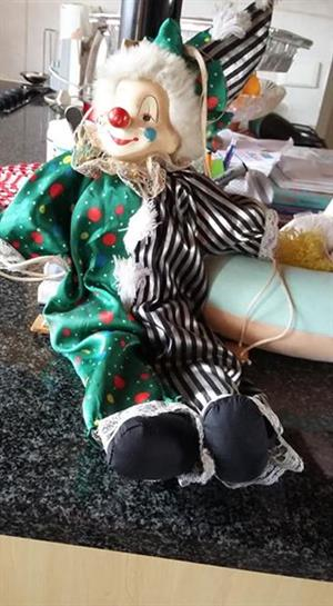 Green dressed clown doll for sale